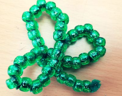Blog Banner Develop hand strength and fine motor skills with this fun beaded shamrock craft.