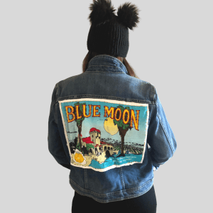 Upcycled and unique soft blue denim jacket with vintage patch