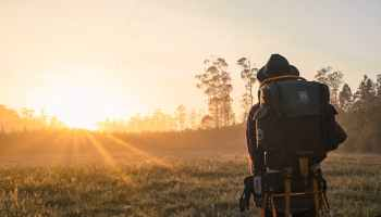 everyday mindfulness activities as illustrated by a man in the photo walking with a backpack
