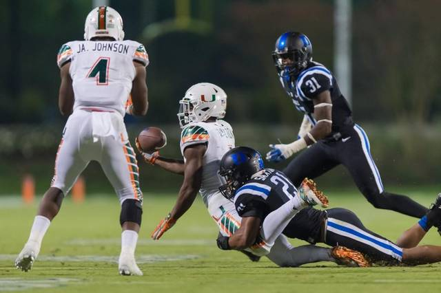 Miami's Mark Walton clearly not being tackled during the Hurricanes' eight-lateral touchdown on the game's final play of Miami's 30-27 win at Duke.