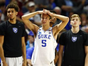 Duke's Luke Kennard and his teammates stare in disbelief