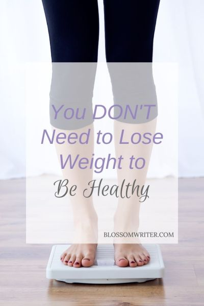 "A picture of a woman standing on a scale. The text reads, ""You Don't Need to Lose Weight to Be Healthy."""