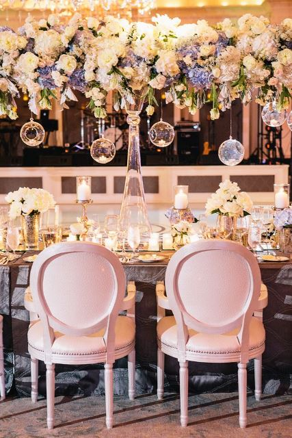 Light blue and white lovely wedding tablescape with hanging floral