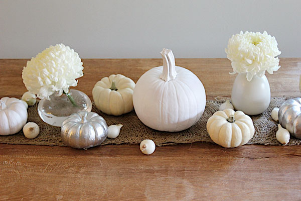 White and silver painted pumpkin centerpieces for Thanksgiving