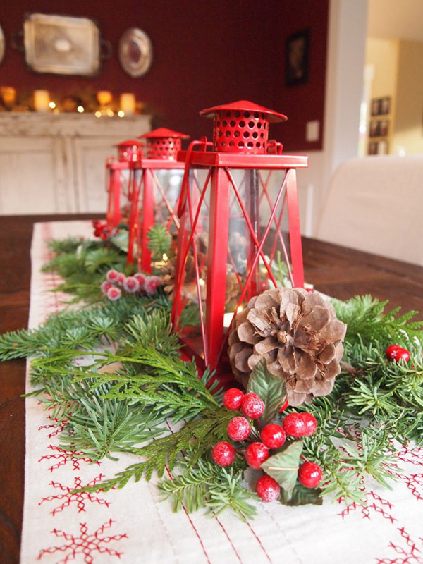 Fresh evergreen and berres lantern centerpiece