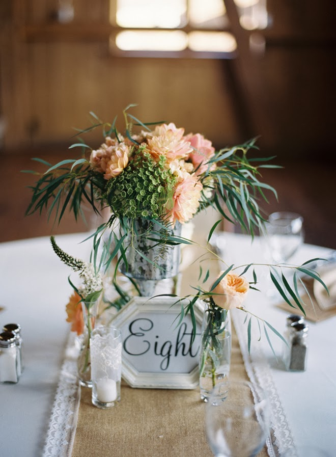 Delicate rustic peach centerpiece b lovely events