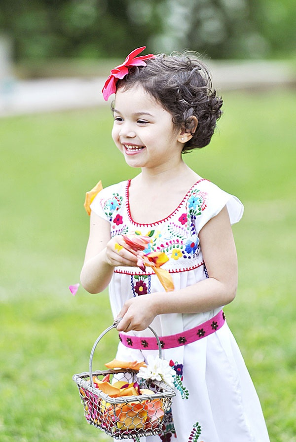 Love this flower girl look for a mexican themed wedding!