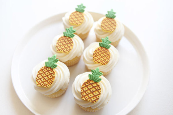 Pineapple Cupcakes and cupcake toppers! - See More Lovely Pineapple Party Ideas At B. Lovely Events!