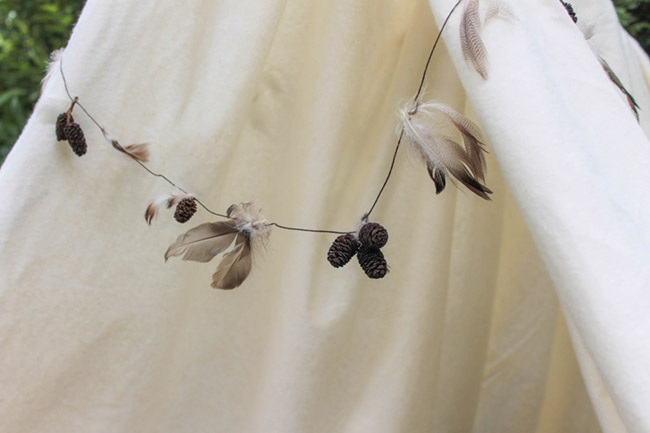 DIY Feather and Pinecone Garland - See More Lovely Kid's Camp Out Ideas on B. Lovely Events
