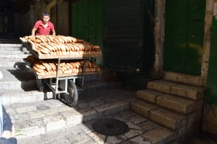 Jerusalem bagels being carted through the streets early Sunday morning.