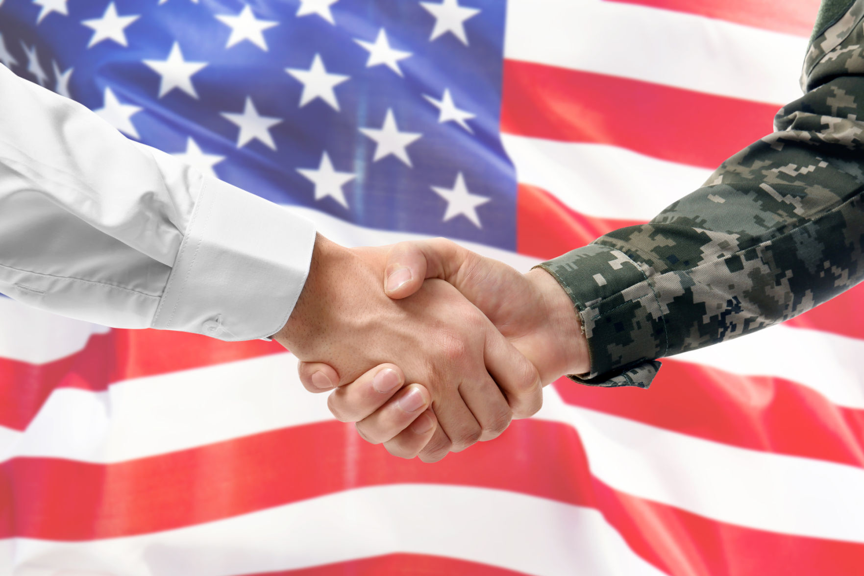 USA military man in uniform and civil man in suit shaking hands with national flag on background - Liberia