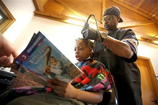 Children read to Iowa barber in exchange for haircuts