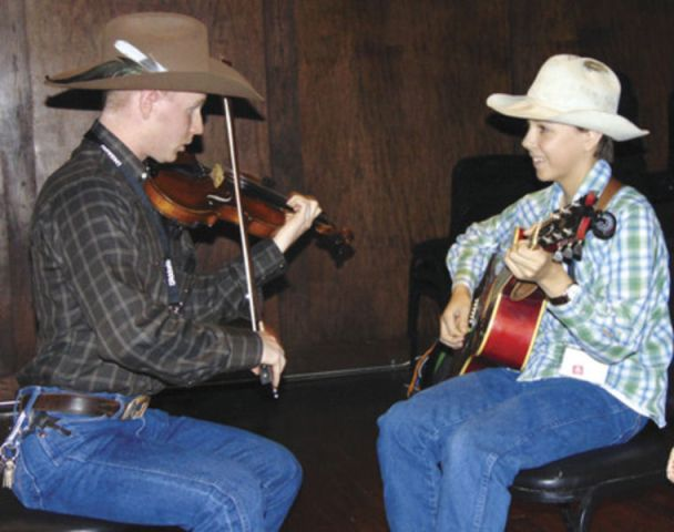 Honoring  King of Western Swing    News   heraldbanner com Chad Matthews  left  of Golden  Colo  played the fiddle while Ridge Roberts  of Granbury plucked the guitar at Landon Winery during a Friday night jam  and