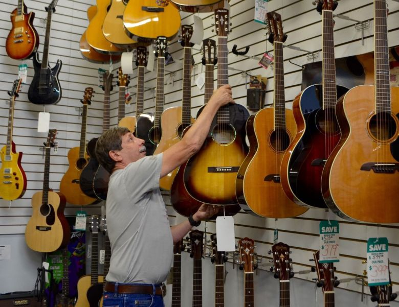 music stores adapt to compete with online distributors | business