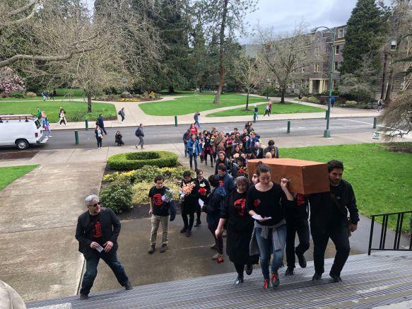 graduate employees mock funeral