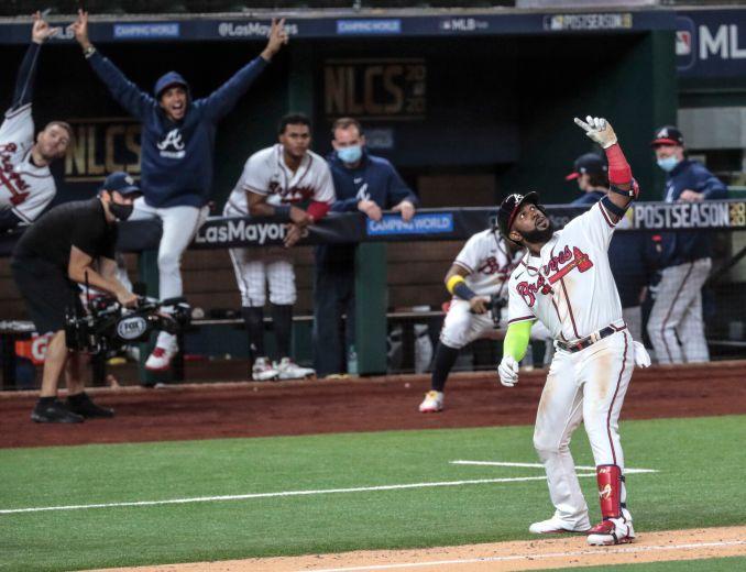 Braves bring back Ozuna on  million, 4-year deal