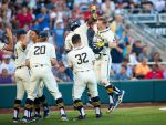 Homers and 'stellar' pitching propel Michigan to win first game of CWS championship series