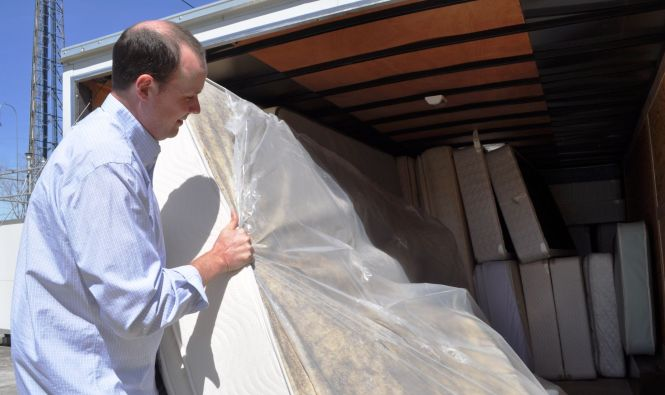 K C Rennie Of Charleston Mattress Loads Used For Recycling Onto Truck