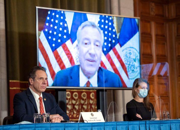 FILE - NY Andrew Cuomo, Bill de Blasio 12-9-2020