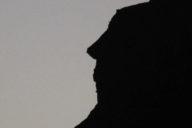 A silhouette of the side of the mountain showing a face much like that of Alfred Hitchcock