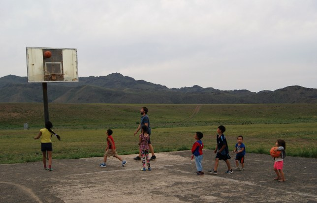 Playing basketballs with the kids.