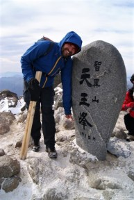 Christophe at 1,915 meters. Woman preparing a soju feast to the right.
