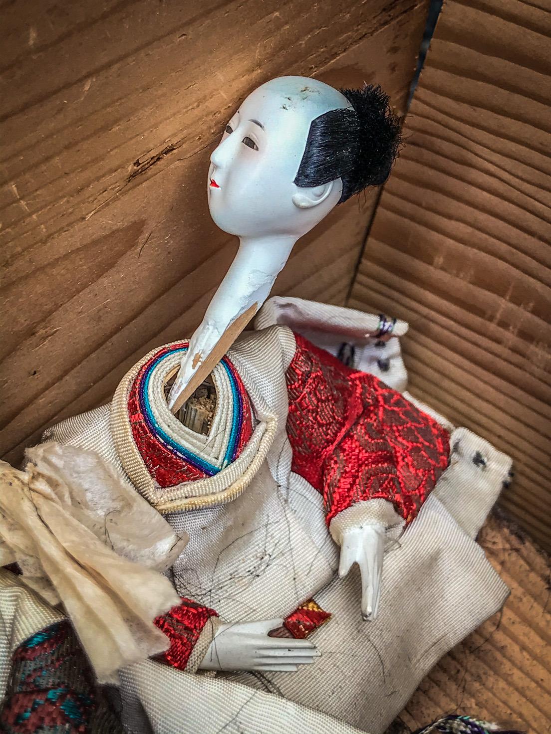 broken hina doll