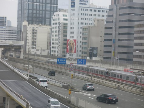 Midousuji line can be seen from Shinkansen platform. It is subway line but it does not run underground in Shin-Osaka. Midousuji line station is located just under Shinkansen platforms.