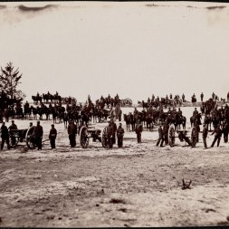 October 2020 J: Keystone Battery Pennsylvania Light Artillery right half. Cannons and caissons and soldiers, positioned across center of image. Tree at left center.