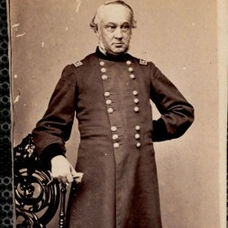 October 2020 N: General H. W. Halleck: Knees up portrait of man standing in U. S. lieutenant general's uniform. Three quarter profile facing toward right of image. Left arm akimbo with hand behind back. Right arm on chair back holding glove in hand. Chair to left of image. [Printed on envelope:] MOLLUS Massachusetts.