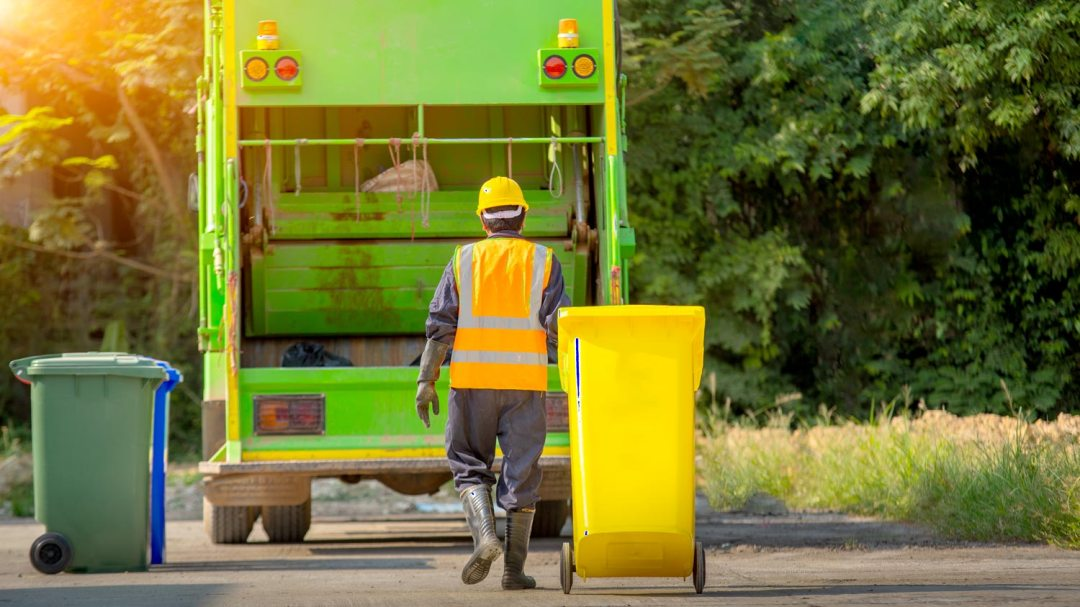 Waste Management image of garbage truck and driver