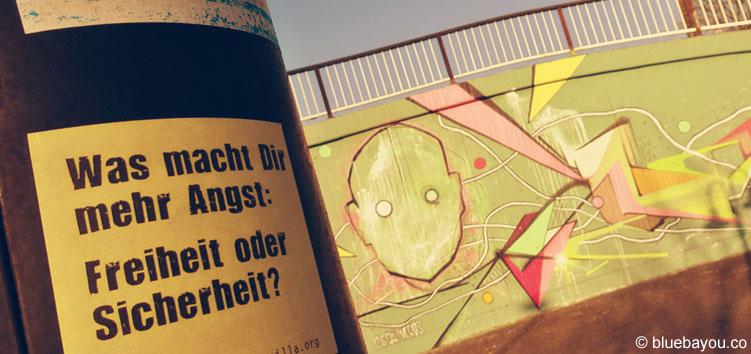 Was macht Dir mehr Angst: Freiheit oder Sicherheit? Post-It der Erinnerungsguerilla am Messepark Trier.