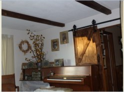 And this is the wonderful feature in the living room - the top-hinged/steampunkesque barn door!