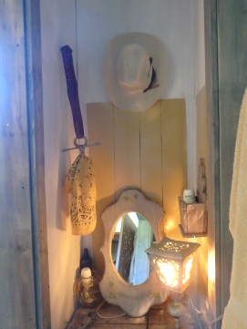 inside the former closet, on ONE side, another bit for towel holder, and a curling iron/make-up station