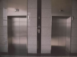 Gray elevators in a residential building.