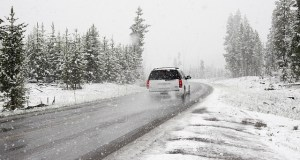 Car on a snowy road - While this may occur, winter is still the best time to rent a storage unit.