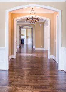 Empty house hallway with wooden floors