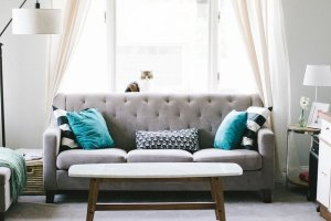 Gray sofa inside a windowed room