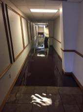 Flooding in the hallway at Hi-Way Tabernacle was minimized by a pump that Pastor Charles Stoker monitored for nine hours.
