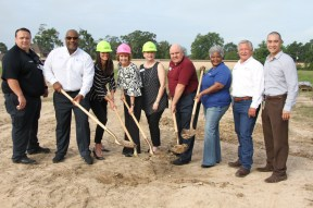 City leaders and representatives from Kingwood Medical Center turn over dirt at the site of KMC's new freestanding emergency department in Cleveland. Pictured left to right are Fire Chief Sean Anderson, Cleveland Mayor Pro Tem Danny Lee, KMC board member Christy Lapeze, KMC CEO Melinda Stephenson, KMC board member Carol Sutton, Greater Cleveland Chamber of Commerce COO Jim Carson, Councilwoman Marilyn Clay, EDC member Robert Reynolds and Dr. Alan Lo, regional medical director for the freestanding emergency departments for HCA, the parent company of Kingwood Medical Center.