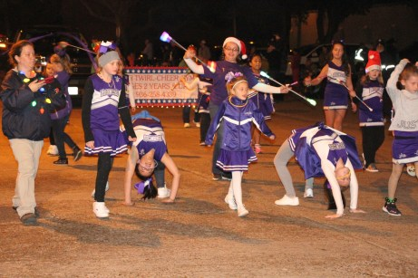 Star Twirlers performed flips and backbends as they walked the parade route for Country Christmas on Nov. 27.