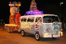 """A fully restored Volkswagen van pulled a float carrying """"The Grinch."""""""