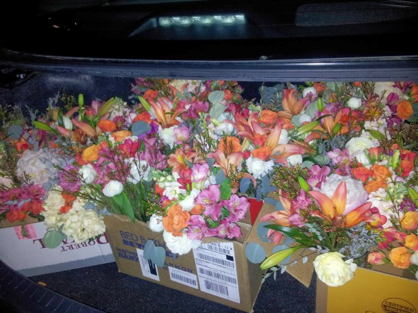 a trunk full of reception flowers