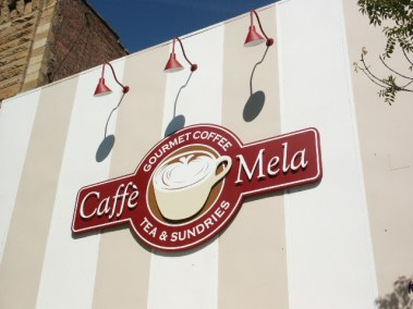 Caffe Mela - wall mounted sign with non illuminated reverse pan with flat cut out letters and logo - Wenatchee, WA