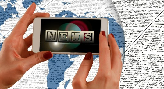 Image of digital media and newspapers
