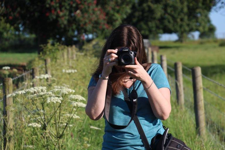 Dr Elaine Massung taking a photo in Wiltshire.