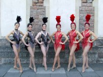 6 Showgirls in black and red costumes