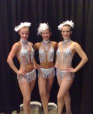 Showgirls in silver bikinis