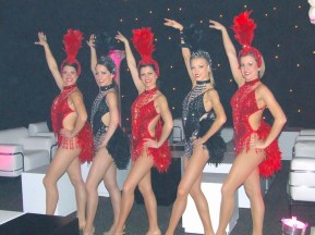 Five showgirls in red and black
