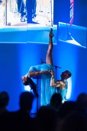 two dancers performing impressive lift
